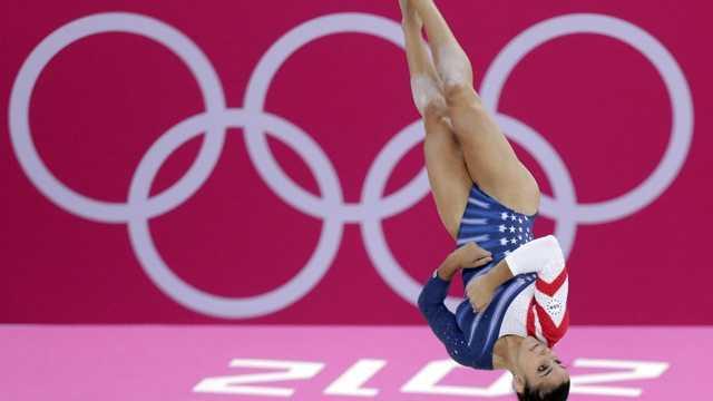 Alexandra Raisman performs during the artistic gymnastics women's floor exercise final.
