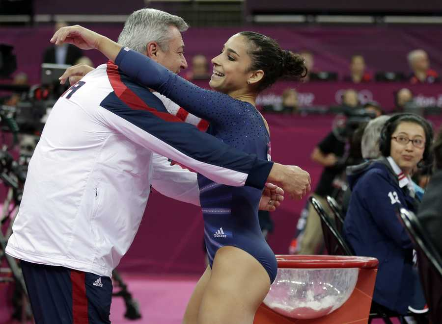 Alexandra Raisman hugs coach Mihai Brestyan after her performance on the floor during the artistic gymnastics women's apparatus finals.