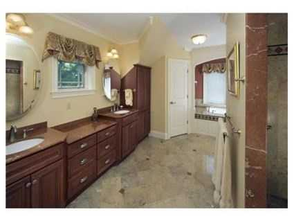 The home includes five full and two partial bathrooms.