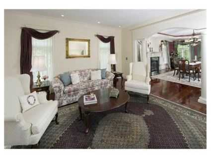 A living room is located off the dining room.