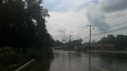 The Chicopee Brook forced the closure of Route 32.