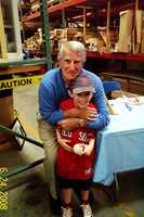 Johnny Pesky with a young fan in June of 2008 at JB Sash & Door in Chelsea during Chelsea Day Celebration.
