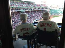 Johnny Pesky and Bobby Doerr look out over Fenway during the park's 100 anniversary celebration on April 20, 2012.  According to the Red Sox, Pesky's last game at the park was on Aug. 5.