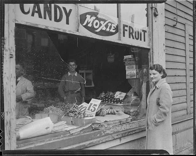 Vandals break in window at store, location unknown.  Photo taken sometime after 1934.
