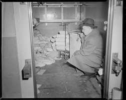 """""""Shortly before 7:30 p.m. on the evening of January 17, 1950, a group of armed, masked men emerged from 165 Prince Street in Boston, Massachusetts, dragging bags containing $1,218,211.29 in cash and $1,557,183.83 in checks, money orders, and other securities,"""" the FBI writes in its account of the crime on its website."""