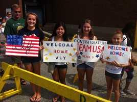 YounggymnastsinBurlingtonwelcome home Olympian Aly Raisman.