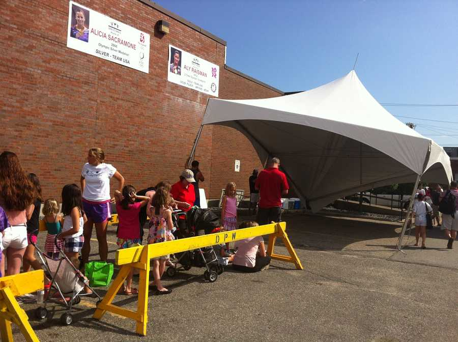 Young gymnasts and fans line up outside Brestyan's Gym in Burlington to meet Olympian Aly Raisman.