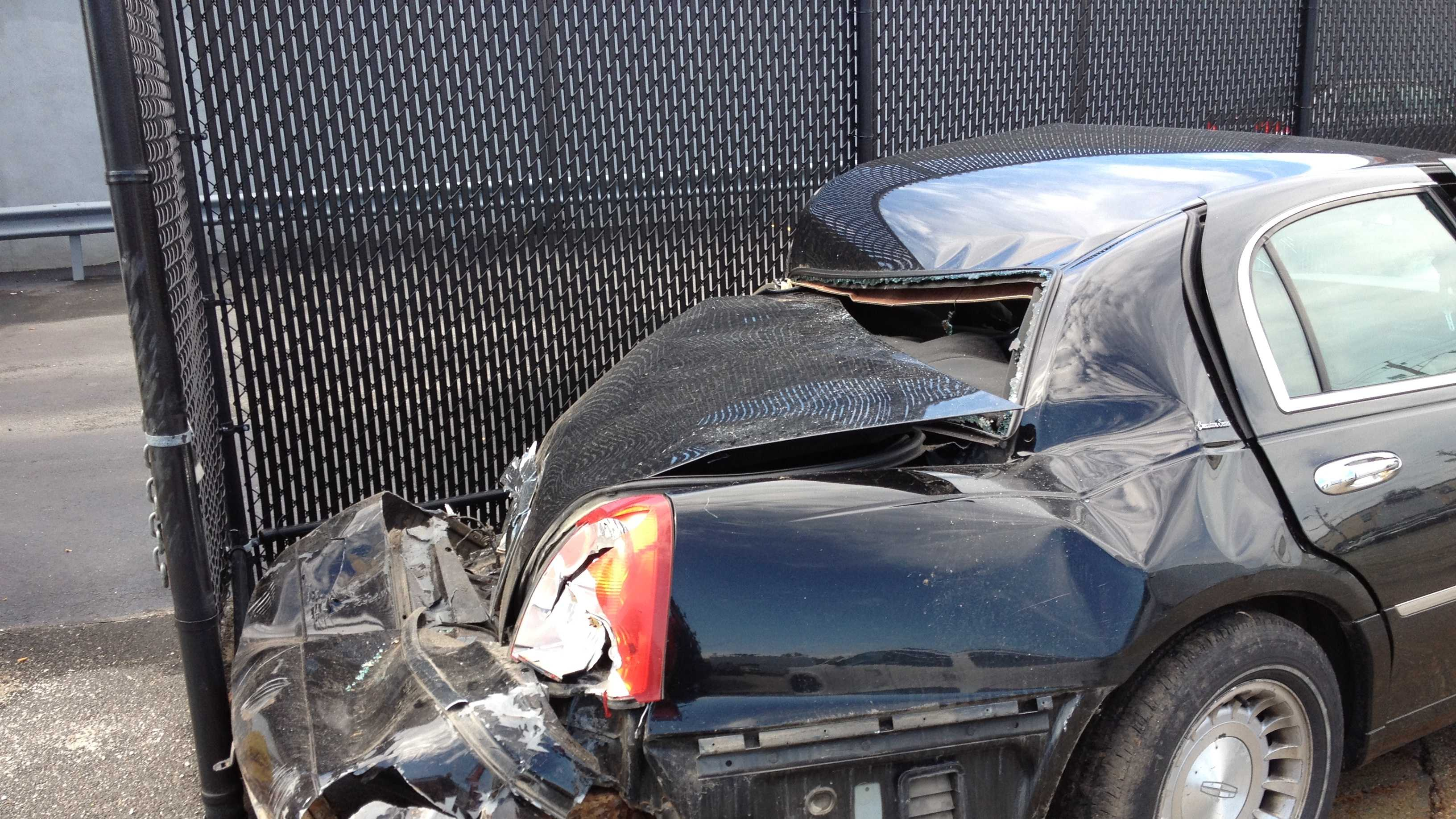 The rear end damage to a car struck by a train in West Medford.