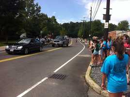 People line up on Ray Ave outside Brestyan's to see Aly Raisman.