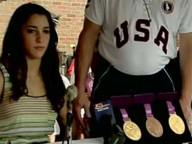Aly sits with her medals