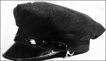 All of the robbers wore Navy-type peacoats, gloves, and chauffeur's caps.