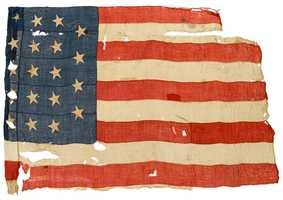 An extremely rare 19-star United States Ensign from the USS Constitution.