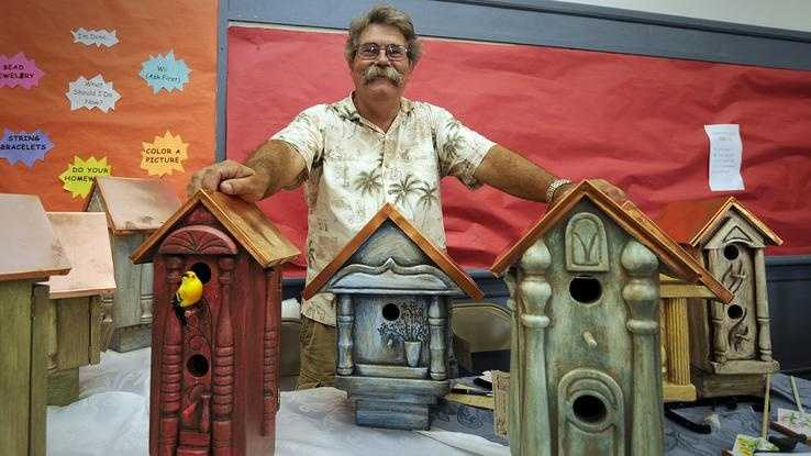 "Marshfield resident Jack Pattison sells his bird ""mansions"" at the arts fair in Pembroke on Saturday, Aug. 11, 2012"