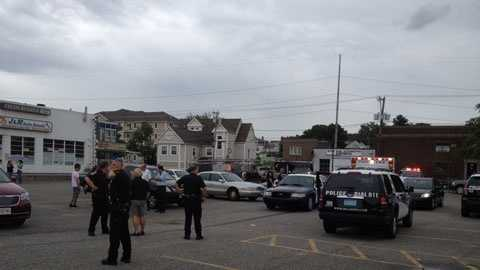 Police investigate a recent shooting in Malden on Aug. 18.