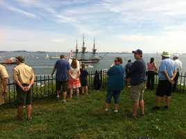 Crowds watching the ship from Fort Independence on Castle Island