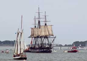The Constitution crew begins to furl some of the sails as it makes its way back into the inner harbor.
