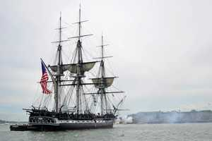 Firing its guns off Fort Independence.