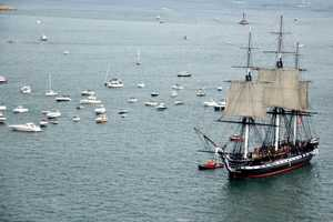The 215-year-old USS Constitution has sailed for the first time since 1997, taking a 17-minute cruise across Boston Harbor.