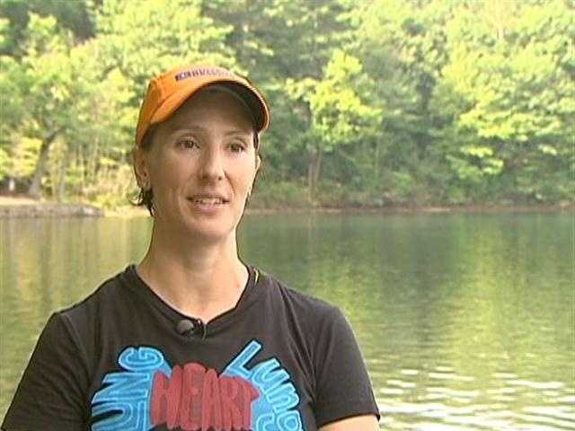 Megan Gurley uses the pond to coach other tri-athletes.