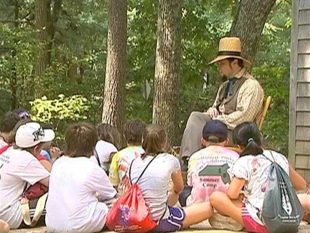 """""""Henry David Thoreau"""" can often be found holding court outside his cabin."""