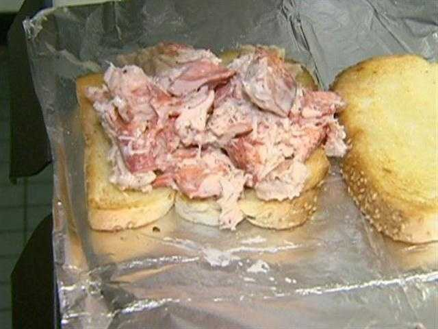The no frills, no filler, sandwich, is served with salt and pepper, on buttered artisan bread.