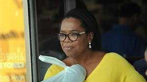 TV talk show queen Oprah Winfrey emerges from Bed Bath and Beyond in Framingham with several bags after a one-hour shopping excursion Thursday.