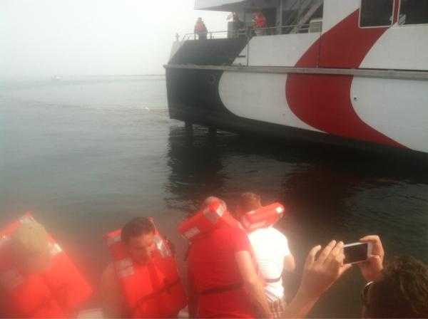 A Provincetown-bound ferry ran aground in Boston Harbor Saturday morning, the Coast Guard said.