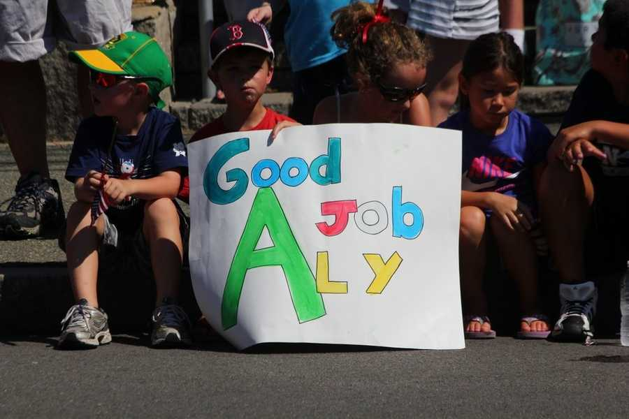 Dozens of people came with signs supporting Aly.
