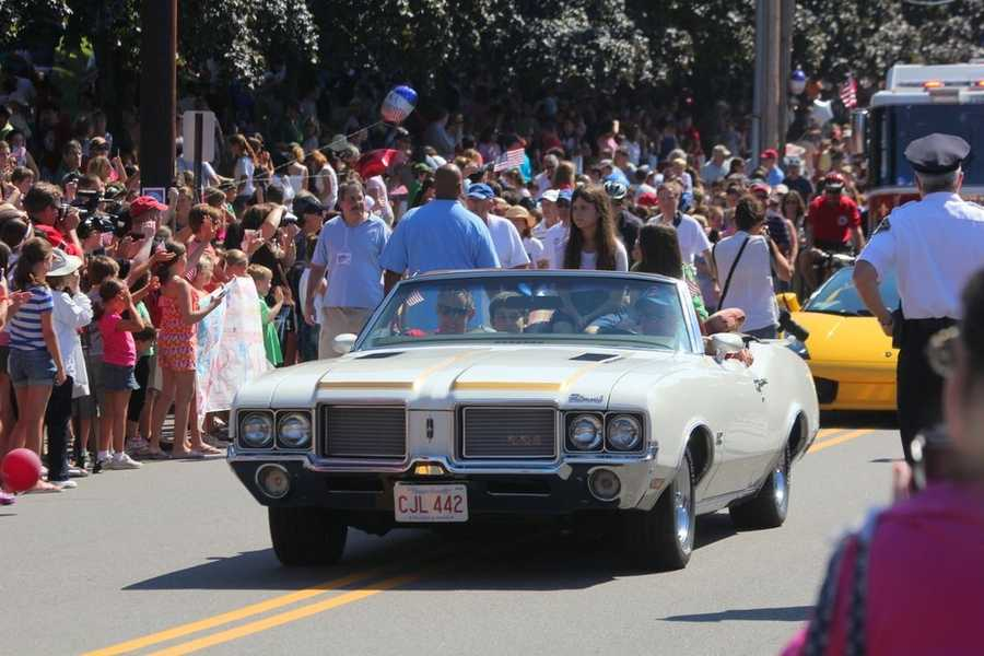 Aly Raisman's family was in the first classic car that passed the massive crowds.