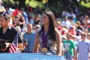 Throngs of spectators cheer on Olympic gold medalist Aly Raisman at her parade in Needham.