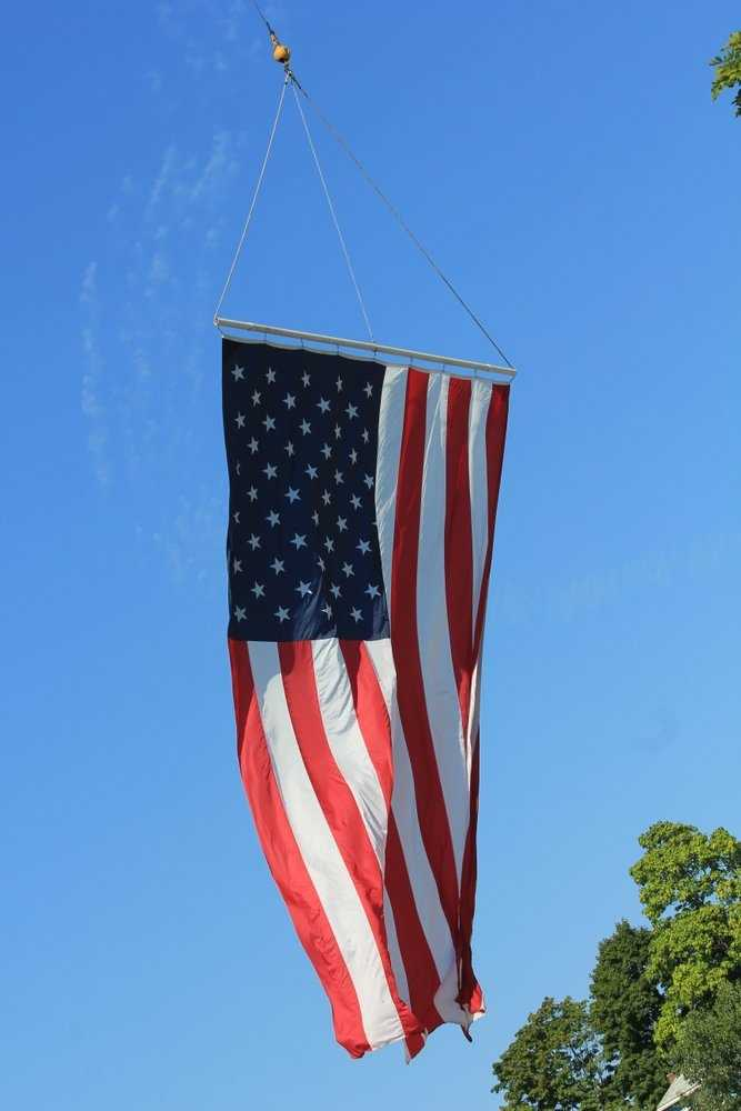 A massive American flag hung over the ceremony.