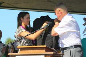 Aly is presented with a Norfolk County Sheriff's Office jacket.