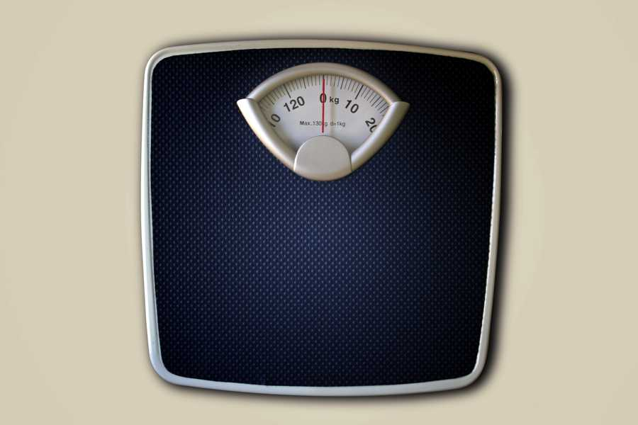 Slow bowel movements may account for excess pounds.
