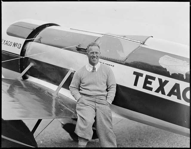 Frank Hawks, a famous early aviator, with his plane at East Boston Airport c. 1930.