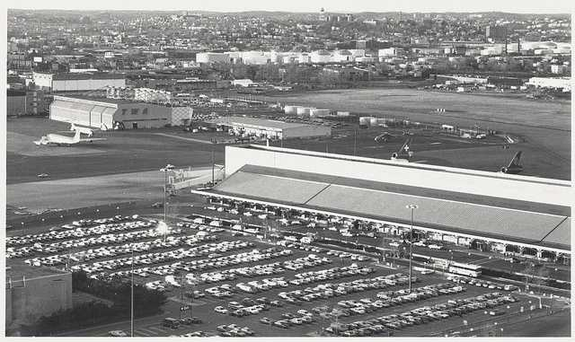 This 1970 view shows a new parking garage being built, a newly completed north terminal, a new southwest terminal in front of a Mohawk hangar, a new airmail facility, 4 maintenance hangars, new customer service area and shows the first use mobile covered walkways for planes.