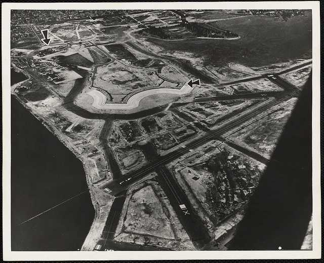 Airside land area is expanded by 1,800 acres from the further filling of Boston Harbor.