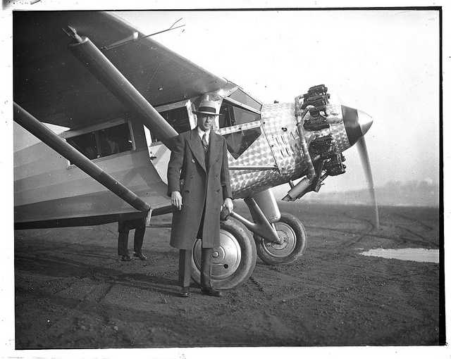 Charles Lindberg stands alongside a plane similar to the famous Spirit of St. Louis in Boston in 1928.