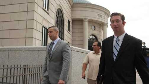 Pleasantville, N.Y., police officer Aaron Hess, left, leaves the courthouse with his attorney.