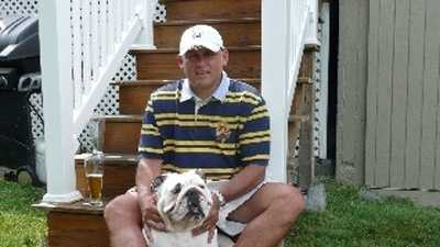 Guy Reynolds with his bulldog, Cooper