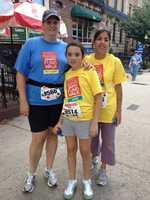 Participants walk along the historic Boston Marathon route. The goal is to raise more than $7.5 million.