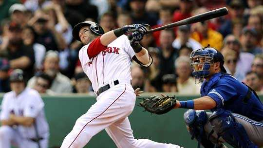 Boston Red Sox's Dustin Pedroia follows through on his home run against the Toronto Blue Jays during the sixth inning of a baseball game at Fenway Park in Boston, Sunday, Sept. 9, 2012.