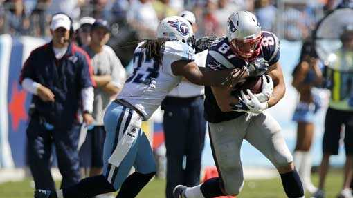 New England Patriots tight end Rob Gronkowski (87) catches a pass as he is defended by Tennessee Titans free safety Michael Griffin (33) in the third quarter of an NFL football game on Sunday, Sept. 9, 2012, in Nashville, Tenn.