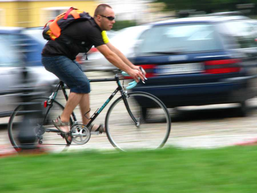 If you open a vehicle door and an oncoming bicyclist hits your door, who is fined?