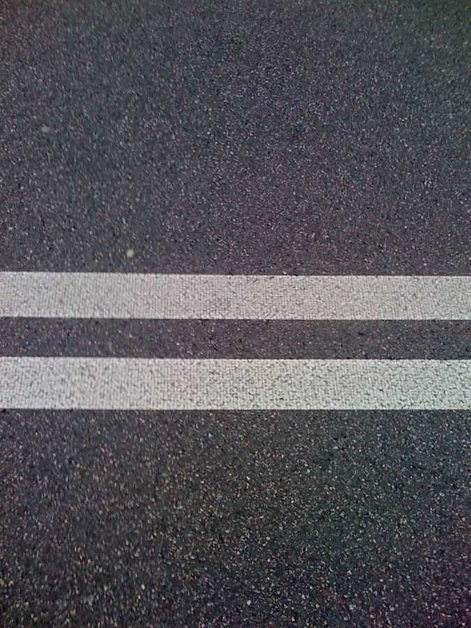 Double solid white lines separate traffic going in the opposite directions. True or False?