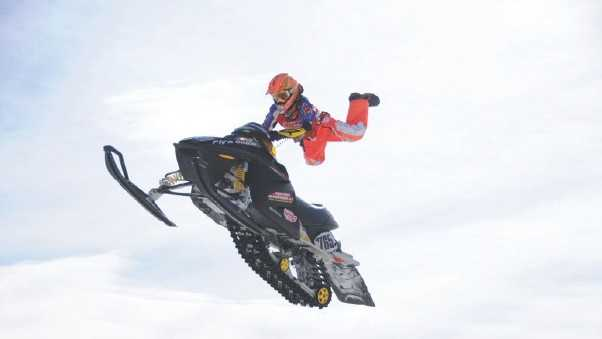 "Montana Jess, doing his ""Superman move"" on his old Ski-doo at a race in Loudon, N.H."