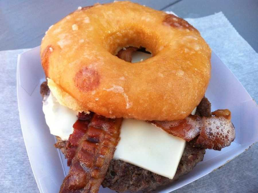 The Big E in West Springfield has more than 140 locations for fair goers to pick up tasty and often unique meals and snacks. The Craz-E Burger is a bacon cheeseburger sandwiched between two halves of a glazed donut!