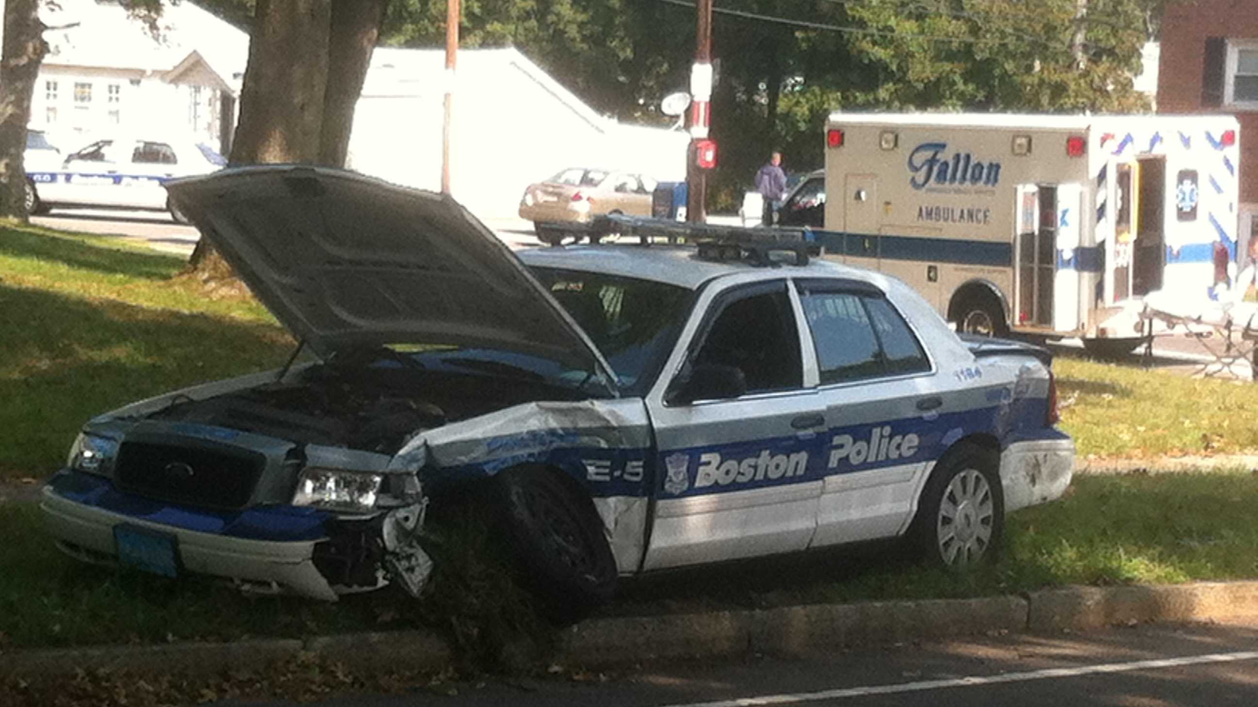 A Boston police officer was injured in a crash on the VFW Parkway on Monday morning.
