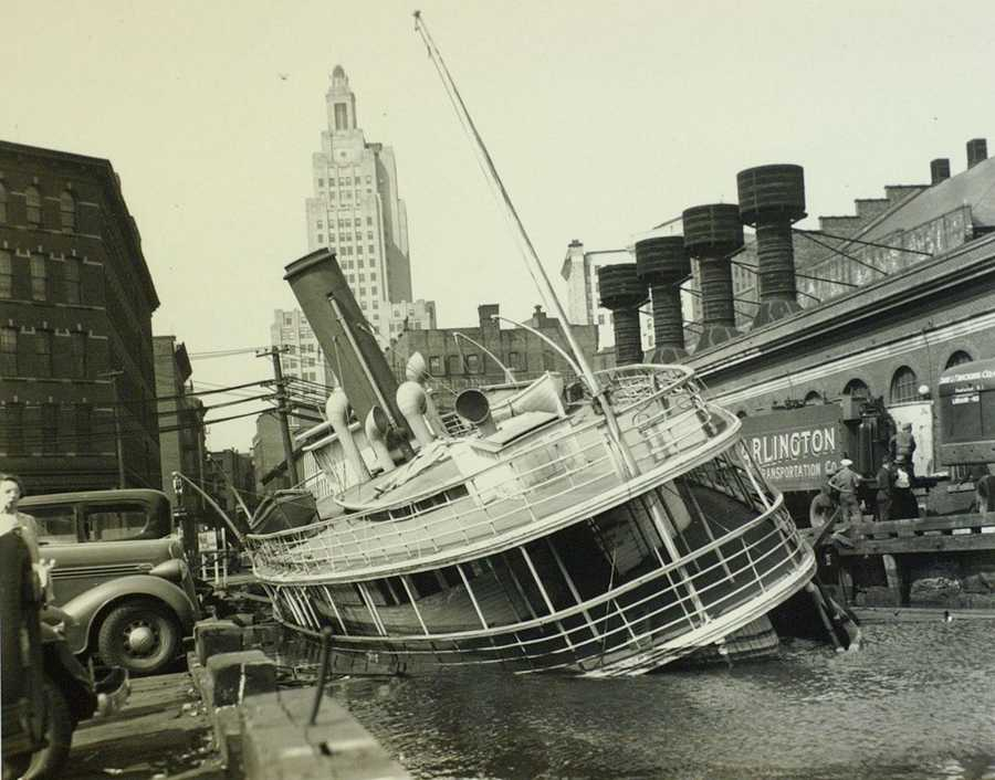 September 1938 photo shows a damaged ferry boat sitting in shallow water in Providence, R.I.