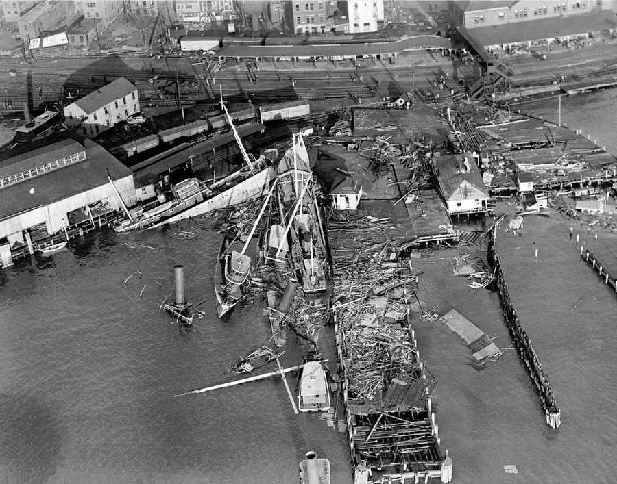 Damaged boats line the New London, Conn., waterfront following the deadly hurricane of 1938