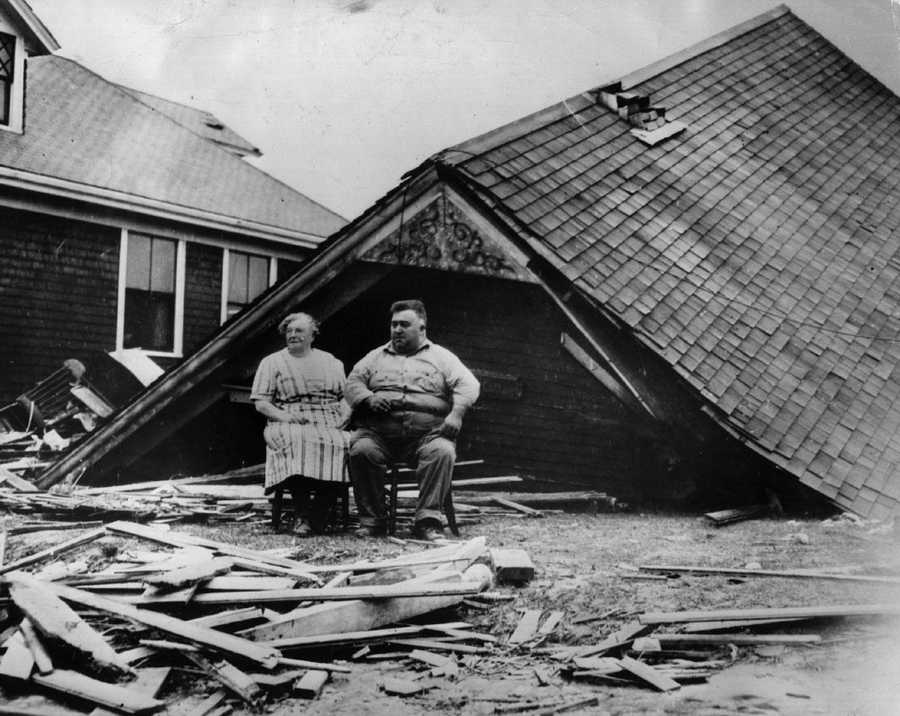 A couple sitting amid the remains of their home at Highland Park, Rhode Island.